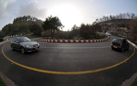 View of a road curve with moving cars. photo