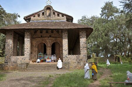 selassie: Gondar, Ethiopia - September 28, 2012: Debre Birhan Selassie Church in Gondar. Ethiopian people in national closes are entering to the church to pray. Editorial