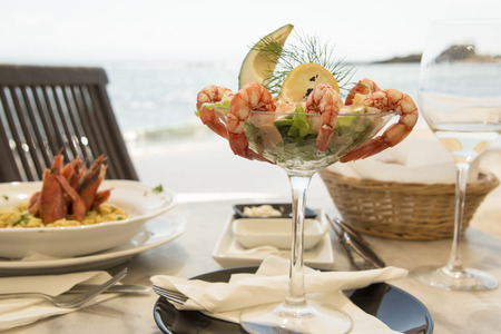 drink at the beach: View of a meal in sea shore restaurant with sea in a background.