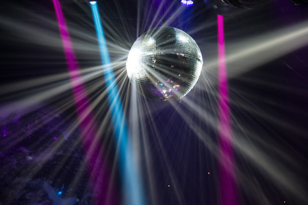blue balls: View of light beams reflecting from a disco ball.