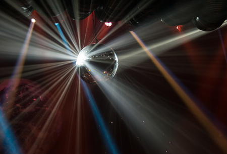 light beams: View of light beams reflecting from a disco ball.