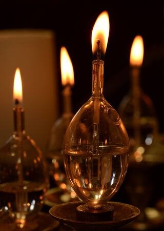 Closeup view of oil candles in synagogue. Stock Photo