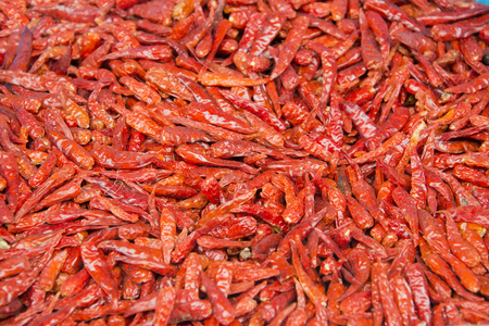 Closeup view of dry red pepper background.