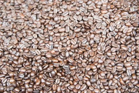 Closeup view of coffee beans background. Фото со стока