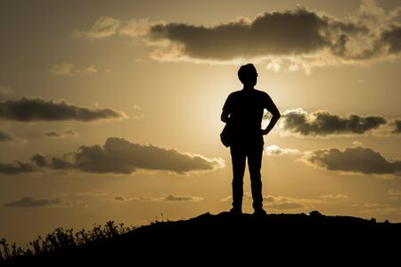 View of man standing outdoor on dawn background. Фото со стока
