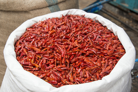 Closeup view of a sack with dry red pepper. Stock Photo