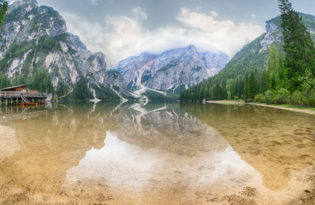 View of a lake surrounded by mountains in the background. Фото со стока