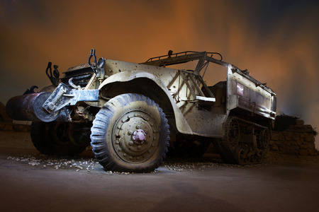 View of an abandoned car in the night illumination