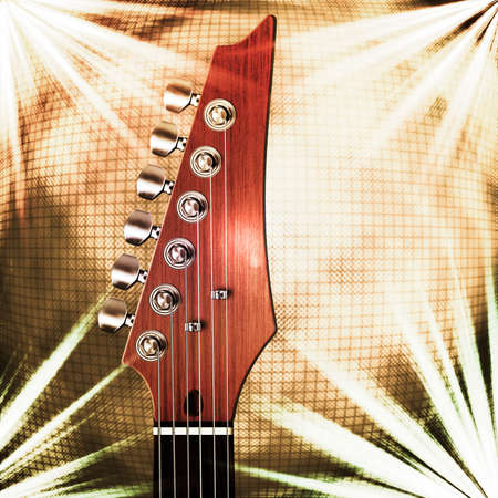 Close up of guitar head stock with light abstraction and mirror ball background.
