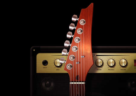 strut: Close up of strut and controls on electric guitar with amplifier. Stock Photo