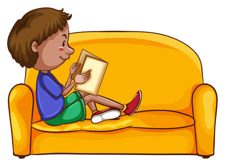 A boy reading while sitting down at the yellow sofa on a white background