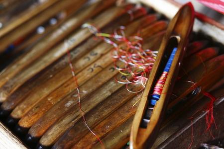 inle: Inle Lake in Myanmar civil weaving shuttles