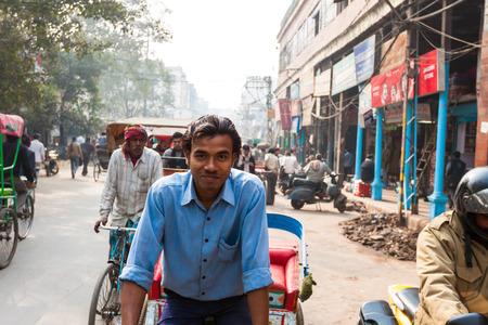 Rickshaw rider close up view in New Delhi, India