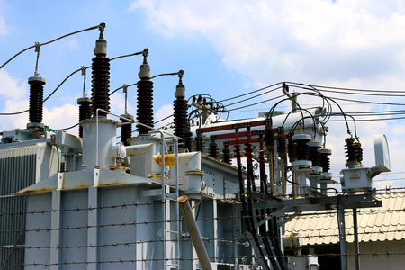 isolator switch: high-voltage substation on blue sky background with switch