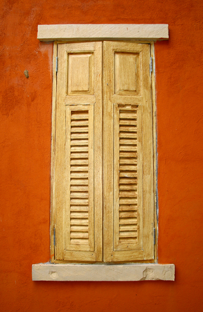 Vintage window on orange cement wall  photo