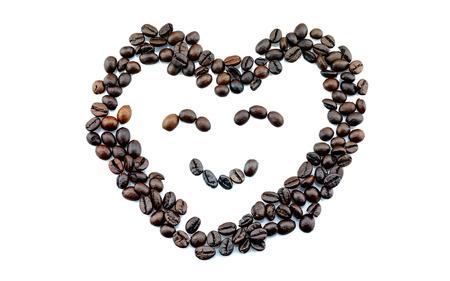 tomando refresco: sonre�r granos de caf� con forma de coraz�n