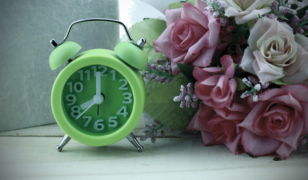 book flowers and a vintage alarm photo