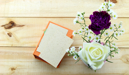 Romantic floral frame background Valentines day backgroundcard and roses on wooden background photo