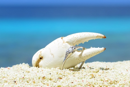 Engagement diamond ring on the tropical beach