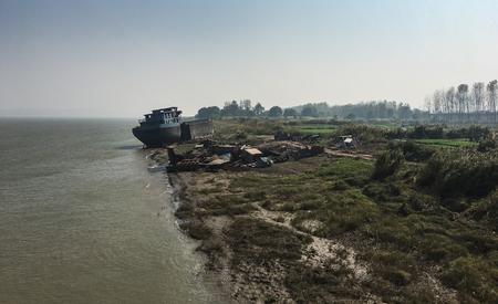View of an old rusty Shipwreck at lakeshore, Along Yangtze River