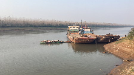 View of an old rusty Shipwreck at lakeshore, Along Yangtze River