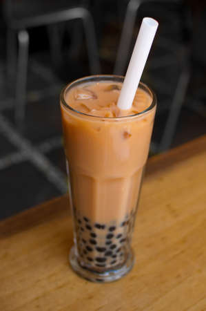 A glass of bubble tea on table.