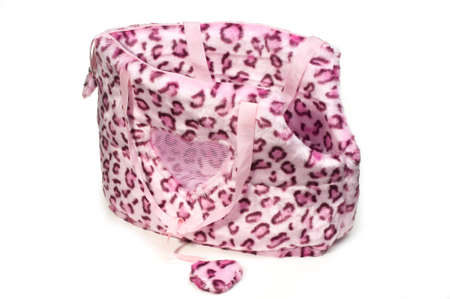 pink leopard print bag for small dogs on isolated white background. Stock Photo