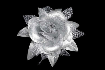 A silver flower hair clip for women on isolated black background. Stock Photo