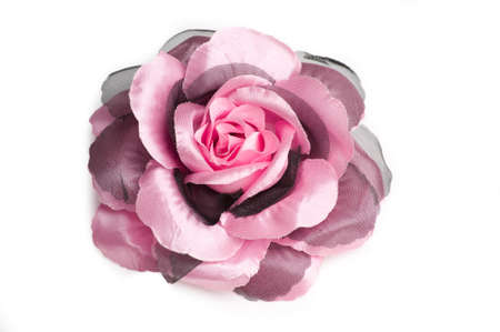 A pink flower hair clip for women on isolated white background.