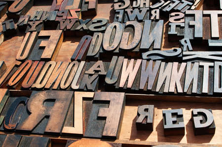 A bunch of old vintage wooden block printing press letters. Stock Photo - 16132190