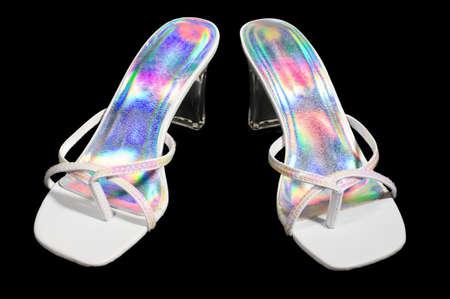 reflective: white and rainbow reflective sandels isolated on black.
