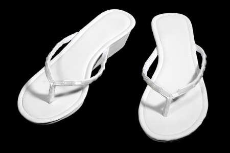sandels: white sandels isolated on black.