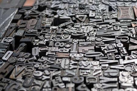 Oude matrijs pers letters en cijfers Stockfoto