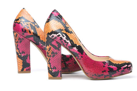 Snakeskin pink snake skin pumps. photo