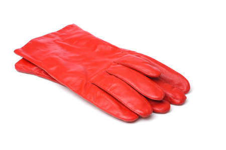 A pair of red leather gloves on white background.