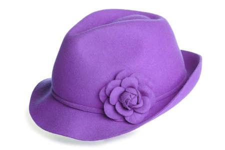 a purple felt hat with a flower on it.