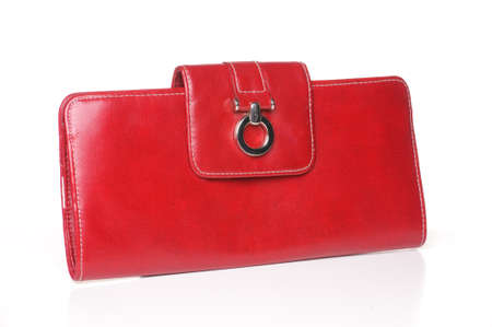 Red leather purse or clutcch on white background.