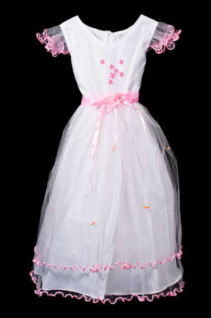 White and pink flower girl wedding dress on black background .
