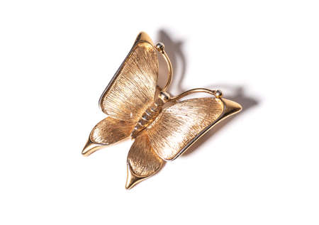 Gold butterfly pendant on white background