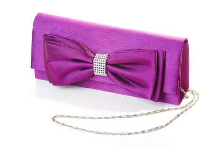 een paarse clutch met strik en diamanten Stockfoto
