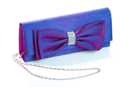 a purple clutch with bow and diamonds