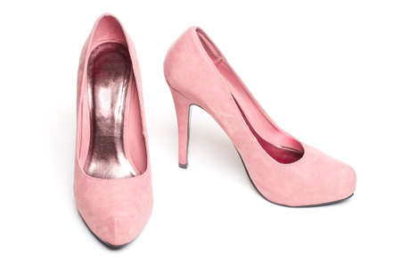pink suade pumps on white isolated background