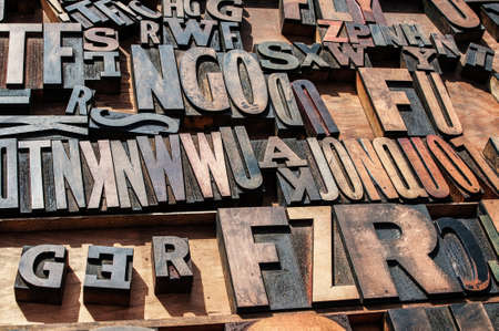 A bunch of old vintage wooden block printing press letters. Stock Photo - 17214779