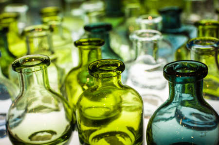 An assortment of empty colorful glass bottles on light box. Stock Photo - 17214753