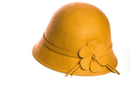 Yellow felt hat on isolated white background.