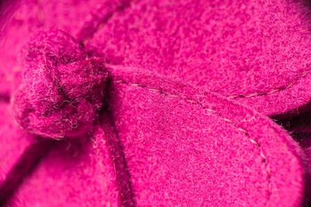 Macro shot of a pink hand made felt flower.