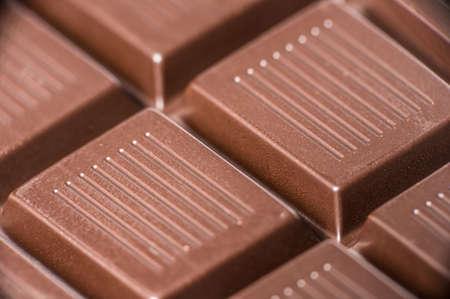 Macro shot of dark chocolate bar cubes. Stock Photo