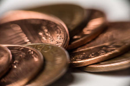Macro shot of copper pennies on white. Stock Photo