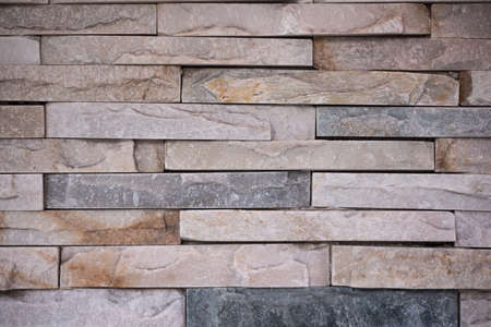 Background shot of layered brown stone wall