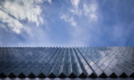 Abstract shot of glass building and blue sky Stock Photo